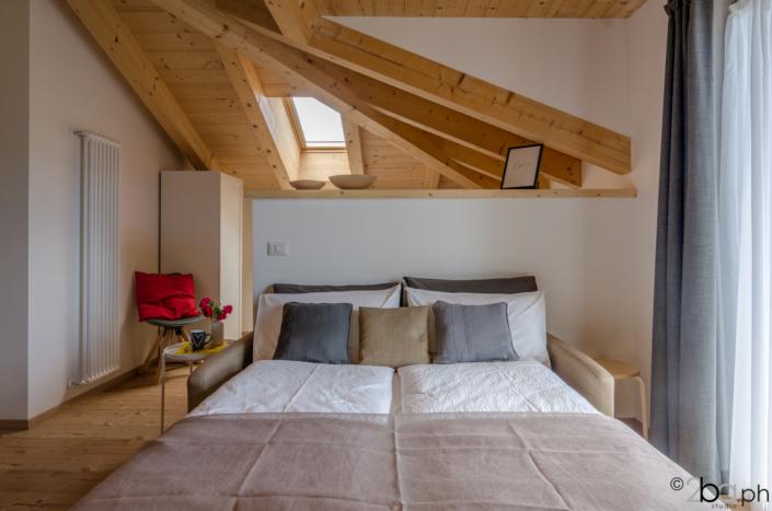 casa di montagna legno mansarda vacanza affitti brevi monolocale divano letto
