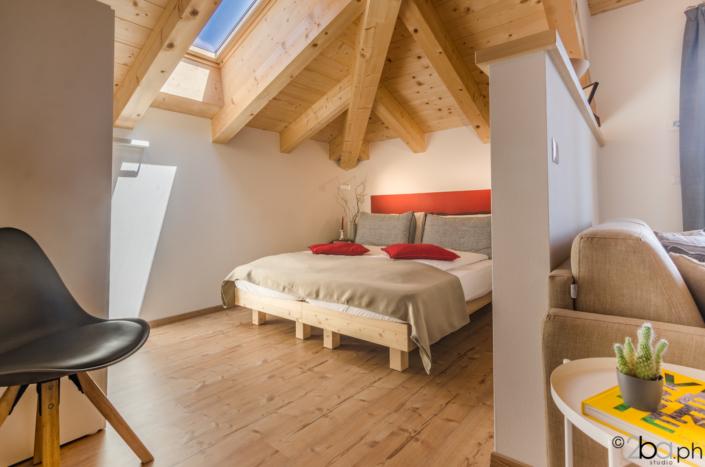 casa di montagna legno mansarda vacanza affitti brevi monolocale letto